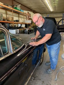Joe sanding classic car